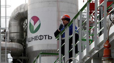 Hang nang luong Rosneft vung tien mua cong ty nho hon - Anh 1