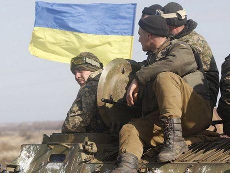 Giao tranh o mien Dong Ukraine, hang chuc nguoi thuong vong - Anh 1