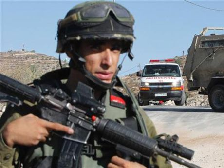 Quan doi Israel ban chet cau be Palestine 10 tuoi - Anh 1