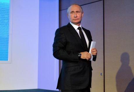 Putin bac bo cao buoc Nga can thiep vao bau cu My - Anh 1