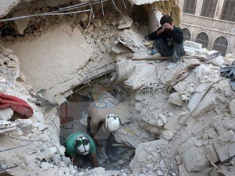 Syria: Danh bom xe o tram kiem soat, hang chuc nguoi thuong vong - Anh 1
