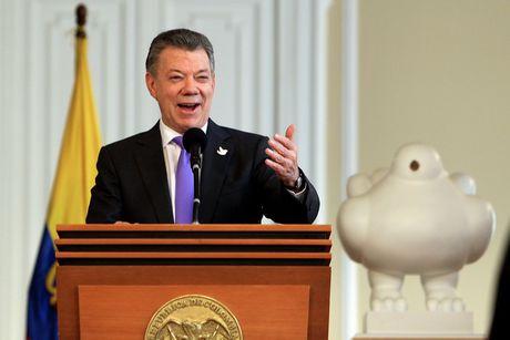 Tong thong Colombia keo dai lenh ngung ban voi FARC den het nam - Anh 1