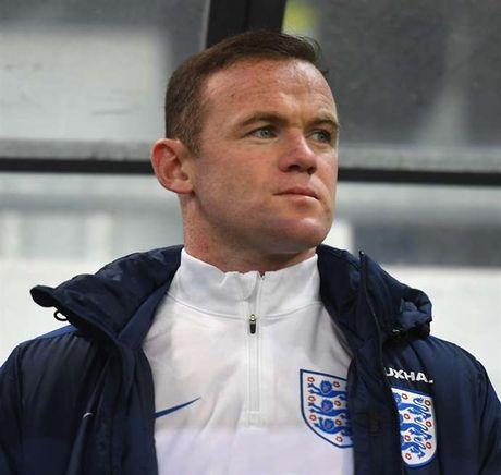 Rooney chap nhan bi ruong bo mot cach day dang cap - Anh 1