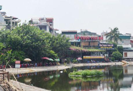 Duong dao quanh ho Quang Trung dang bi chiem dung - Anh 1