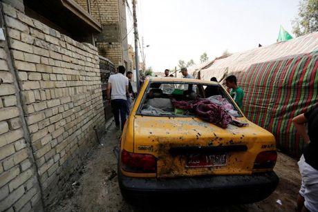 Hien truong danh bom kinh hoang o Iraq, hang chuc nguoi chet - Anh 6