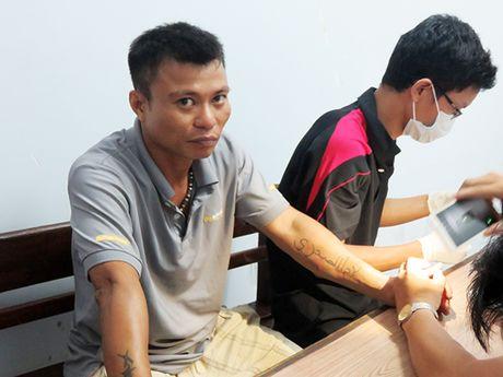 Da Nang: Bat nghi pham giet nguoi tan doc, moc 2 mat nan nhan chi sau 8h truy xet - Anh 1