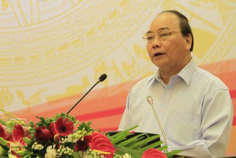 Xoa doi giam ngheo: Nguoi dan can 'can cau' chu khong phai 'con ca' - Anh 1