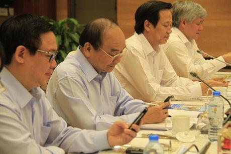 Xoa doi giam ngheo: Nguoi dan can 'can cau' chu khong phai 'con ca' - Anh 2