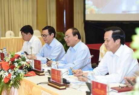 Xoa doi giam ngheo: Nguoi dan can 'can cau' chu khong phai 'con ca' - Anh 3