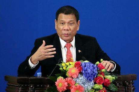Bo truong Philippines phai 'dich lai' tuyen bo tam biet My cua ong Duterte - Anh 1