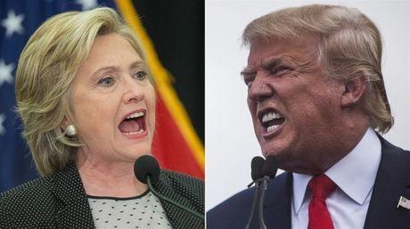 Ong Trump bat ngo tang toc, ap sat ba Clinton - Anh 1