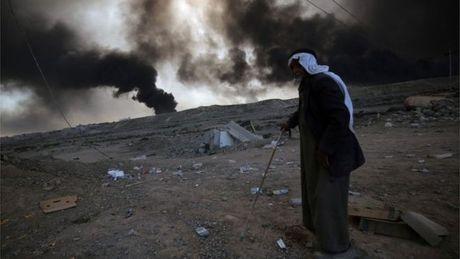 IS tan cong phia Tay Iraq, cuoc chien o Mosul van tiep dien - Anh 1