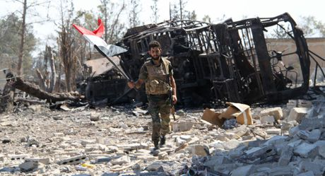 Quan doi Syria kiem soat hoan toan don vi phong khong Aleppo - Anh 1