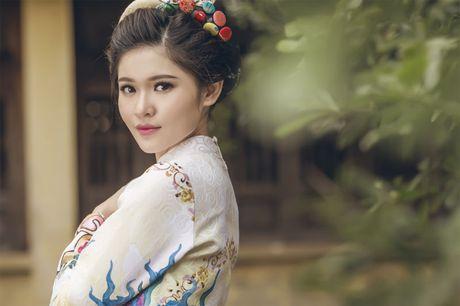 Ngam 'co Tam' cua Hoa hau Viet Nam trong ao dai truyen thong - Anh 8