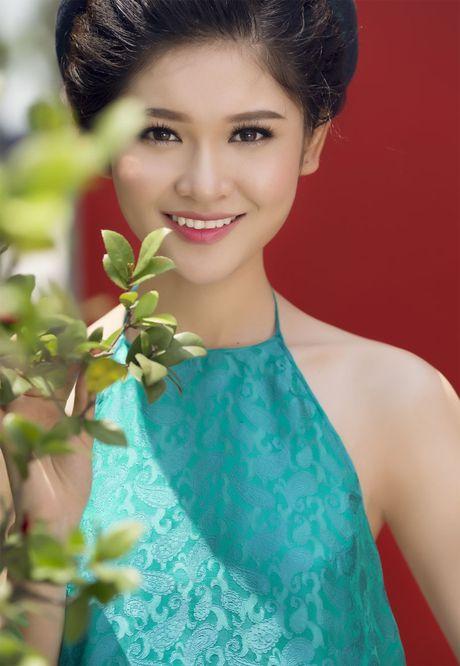 Ngam 'co Tam' cua Hoa hau Viet Nam trong ao dai truyen thong - Anh 9