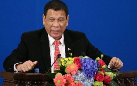 Philippines quyet khong nhan nhuong Trung Quoc vu bai can Scarborough - Anh 1