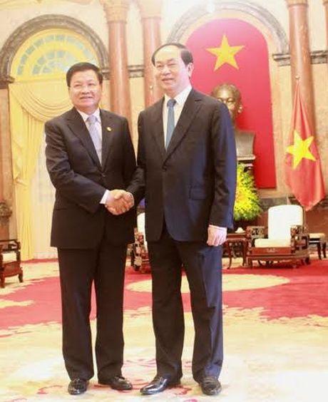 Chu tich nuoc Tran Dai Quang tiep Thu tuong Lao Thongloun Sisoulith - Anh 1