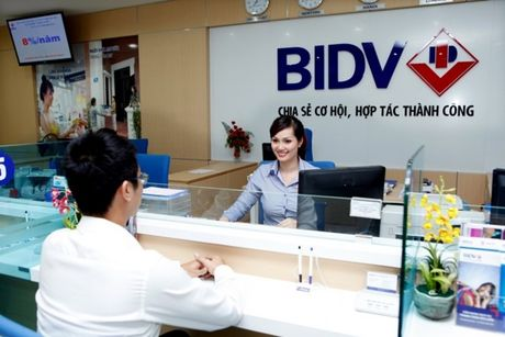 BIDV: Loi va hai khi tra co tuc bang tien mat - Anh 1