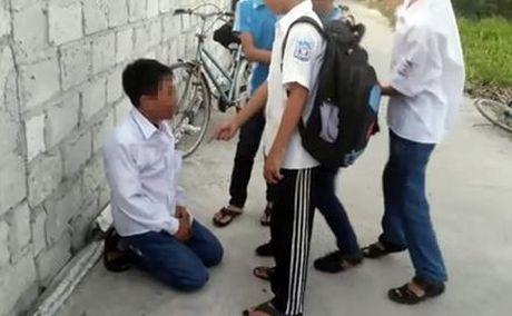 Hoc sinh lop 7 bi danh dap vi thieu nam nghin dong 'nop to' - Anh 1