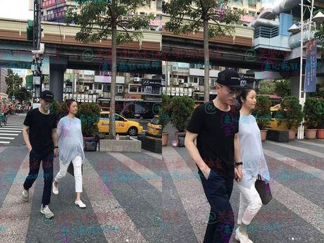 Lam Tam Nhu bung bau 6 thang nam chat tay chong tren pho - Anh 1