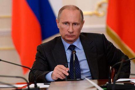 Tong thong Putin: Nga khong banh truong, khong lam ba chu toan cau - Anh 1