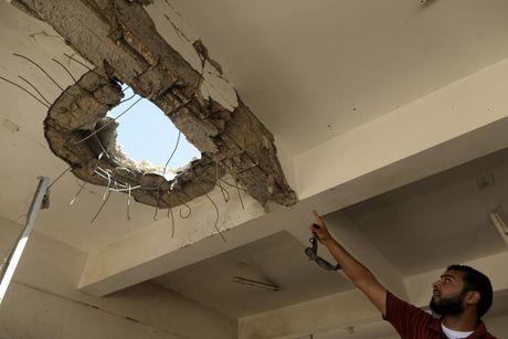 Le tot nghiep trong truong dai hoc bi danh bom o Libya - Anh 11