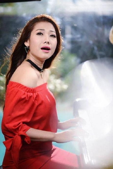 Ca si tre Huynh Mi va niem dam me chay bong - Anh 1