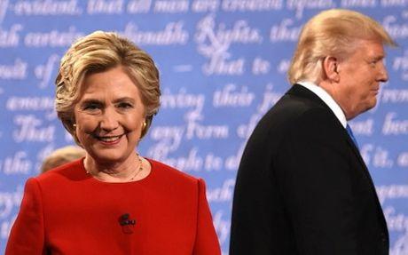 Bau cu My: Clinton tiep tuc bo xa Trump trong cac cuoc bo phieu som - Anh 1