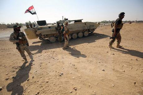 Luc luong an ninh Iraq tien vao ngoai o thanh pho Mosul - Anh 1