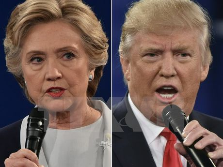 Ong Donald Trump bat ngo vuon len dan truoc ba Hillary Clinton - Anh 1