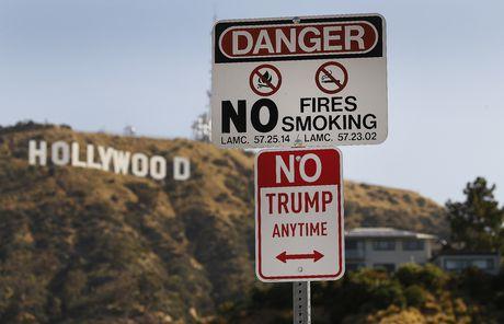 Trump, Clinton: Tran trui va day khieu khich - Anh 4