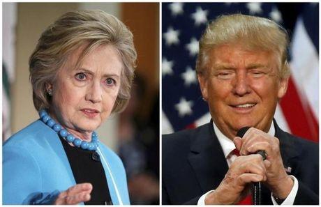 Clinton va Trump tiep tuc cong kich nhau; Clinton dang dan truoc - Anh 1