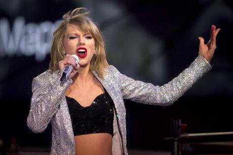 Taylor Swift danh bai Adele ve tai kiem tien - Anh 1