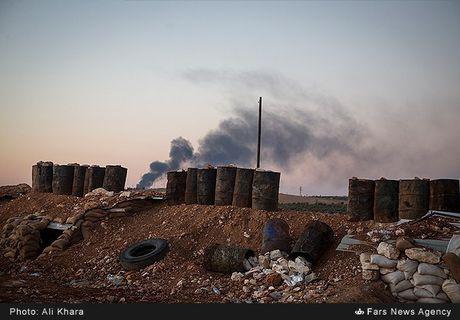 Quan doi Syria tan cong don dap khung bo tai Aleppo - Anh 11