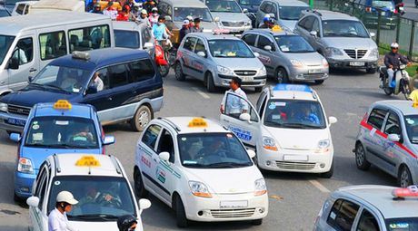 Taxi ngoai tinh - ap luc lon cho giao thong Thu do - Anh 1
