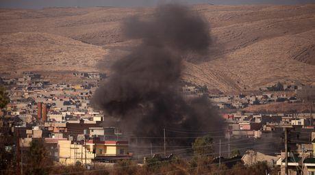Iraq phat hien 100 thi the khong dau trong truong hoc - Anh 1