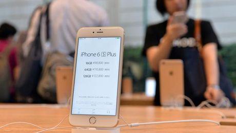 Apple lan dau ban iPhone tan trang - Anh 1