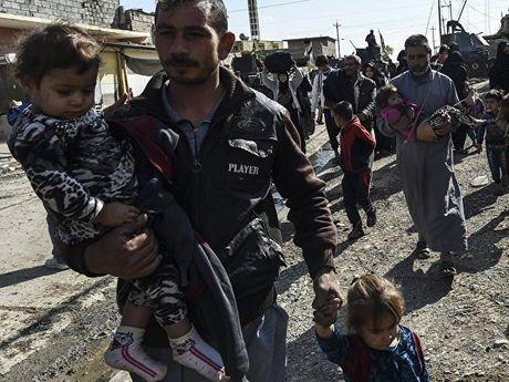 Nguoi dan Iraq bat dau tro ve nhung khu vuc tung bi IS chiem dong tai Mosul - Anh 1