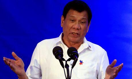 Duterte noi se khong co nhan quyen voi IS xam nhap Philippines - Anh 1