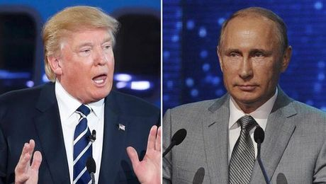 Tong thong Putin va ong Trump lan dau dien dam - Anh 1