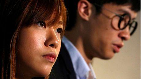 Hong Kong: 2 nghi si tre chong Trung Quoc mat ghe - Anh 1