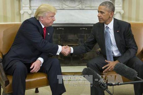 Tong thong Obama keu goi ong Trump gui thong diep doan ket sau bau cu - Anh 1
