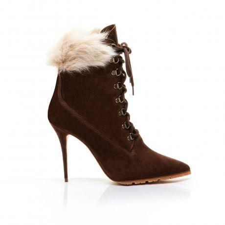 Rihanna tiep tuc 'bat tay' Manolo Blahnik tung BST Boots cho mua mot nay - Anh 6