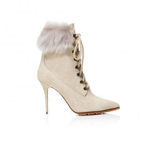 Rihanna tiep tuc 'bat tay' Manolo Blahnik tung BST Boots cho mua mot nay - Anh 7