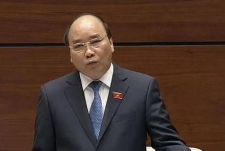 Thu tuong chinh phu Nguyen Xuan Phuc tra loi chat van quoc hoi - Anh 1