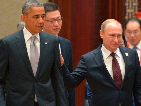 Tong thong Obama 'ngang chan' khi ong Trump quan he voi Nga? - Anh 1