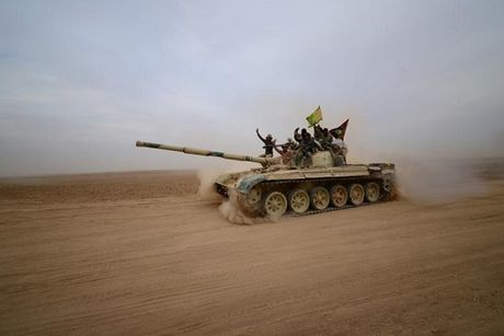 Nghi an IS sat hai 300 cuu canh sat o Mosul - Anh 1