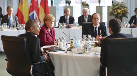 Obama va cac lanh dao chau Au nhat tri tiep tuc trung phat Nga - Anh 1