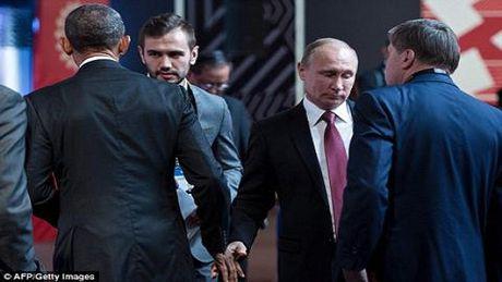 Cuoc gap mat 'lanh lung nhat' trong lich su cua Obama va Putin - Anh 1
