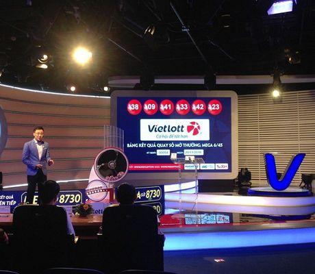 Hon 1 thang, 4 nguoi trung thuong tien ti: Doanh thu Vietlott tang vot - Anh 1